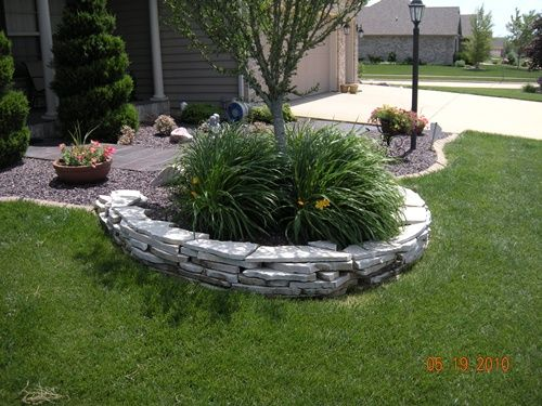 Natural stone drystack wall daylilies brick paver edging for Tree edging border ideas