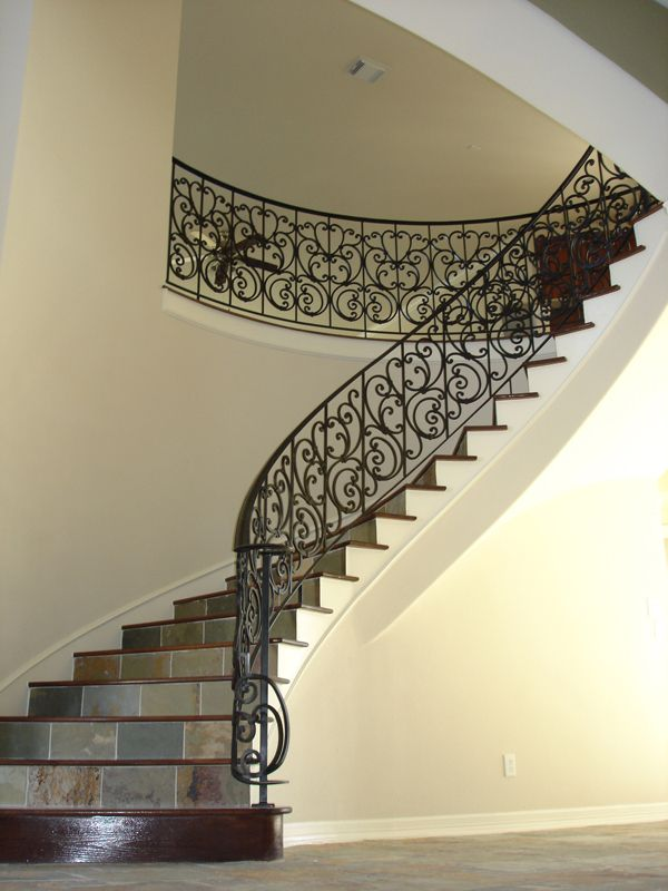 This Staircase Features Wrought Iron Spiraled Panels The Intricately Designed Tuscany Panels A Cheap Stair Parts Iron Stair Railing Wrought Iron Stair Railing
