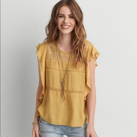 American Eagle top It was $39.99 size large very pretty Soft gauze  • Flowy silhouette  • Scoop neck  • Flutter sleeves  • Lace placket   100% Rayon American Eagle Outfitters Tops Blouses