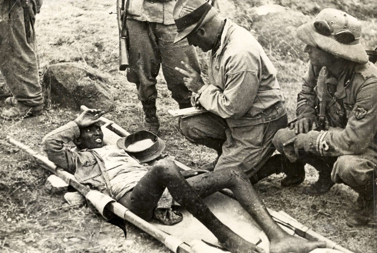 Italian invasion of Abyssinia (Ethiopia), 1935: Italian officers  interrogate an enemy soldier, who has been peppered with s… | Military  heroes, History, World war i