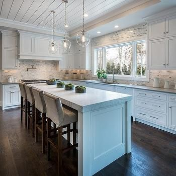 White Kitchen Island With Thick Marble Countertop And Gray Velvet