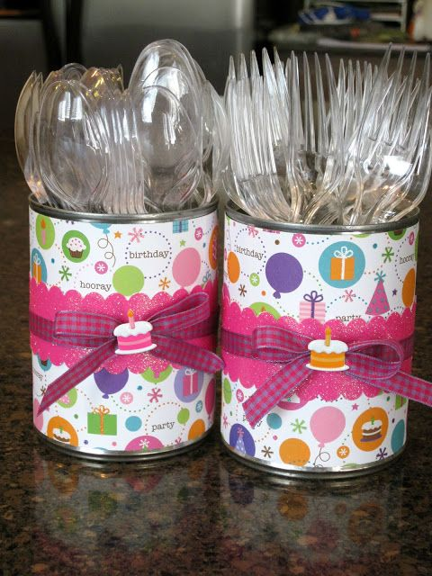 Decorate Soup Cans with wrapping paper to hold utensils.   Make sure to sand down the insides so no one gets cut.