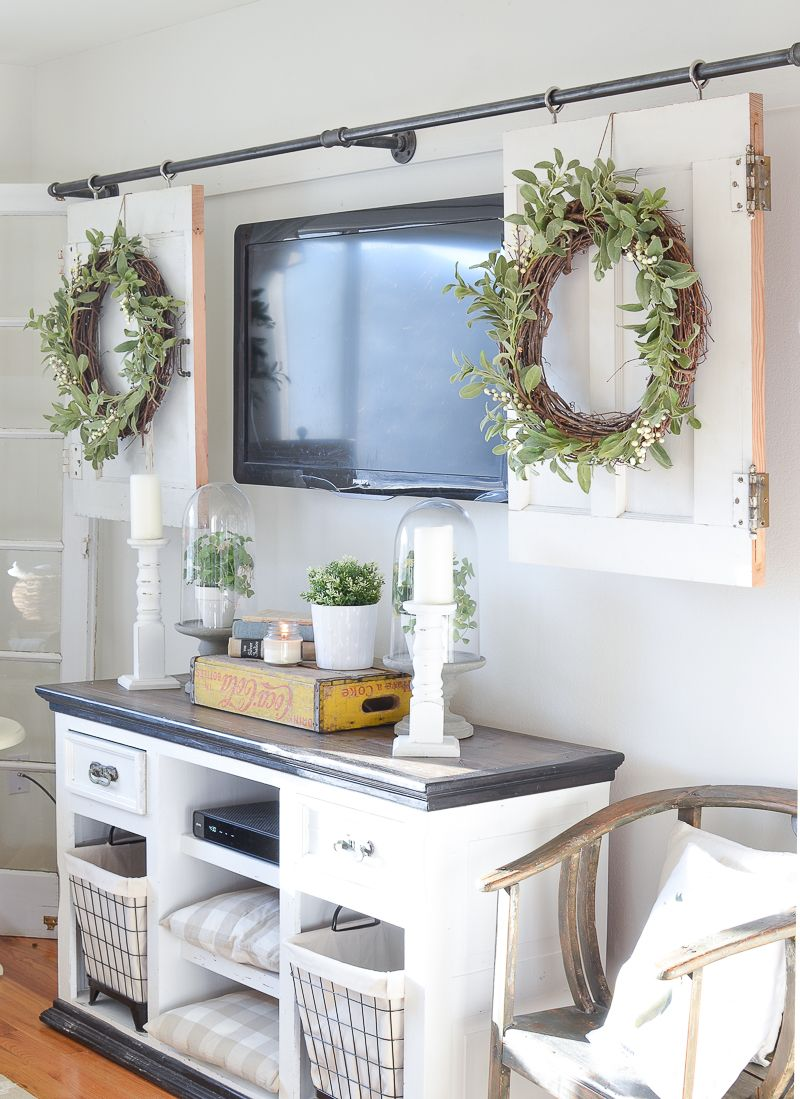 Diy television cover with old doors living room decor around tv stand ideas for also like the wreath behind couch our first home pinterest rh