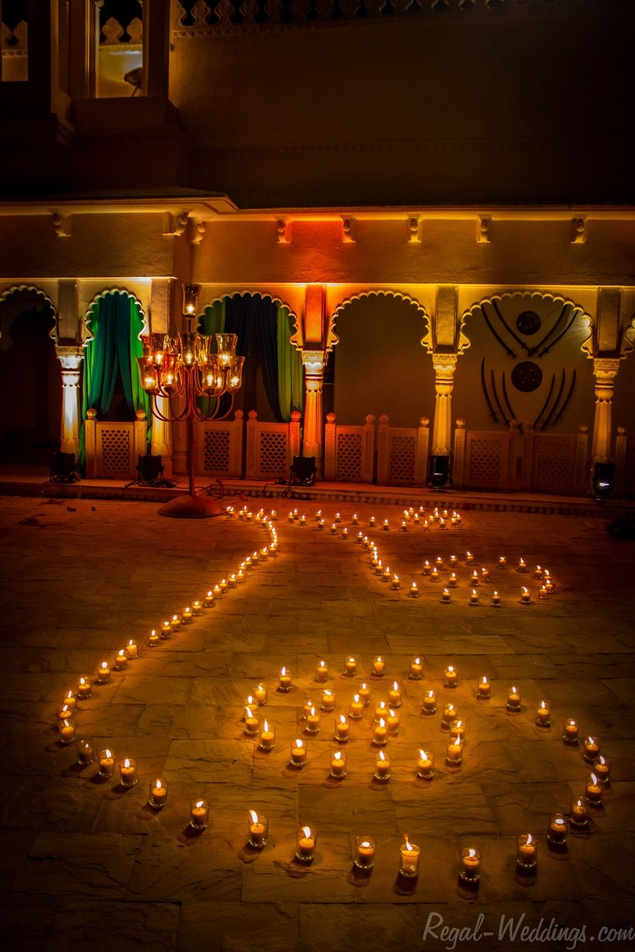 Simple wedding stage decoration at home  Candle decor at Udai Vilas Destination Weddings by Ankit  Ankit