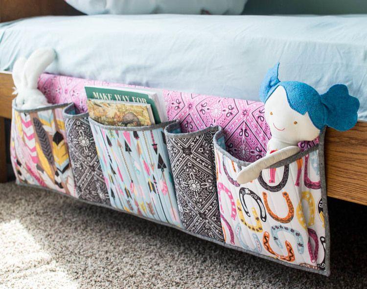 I designed and sewed up some bedside storage pockets like the ones