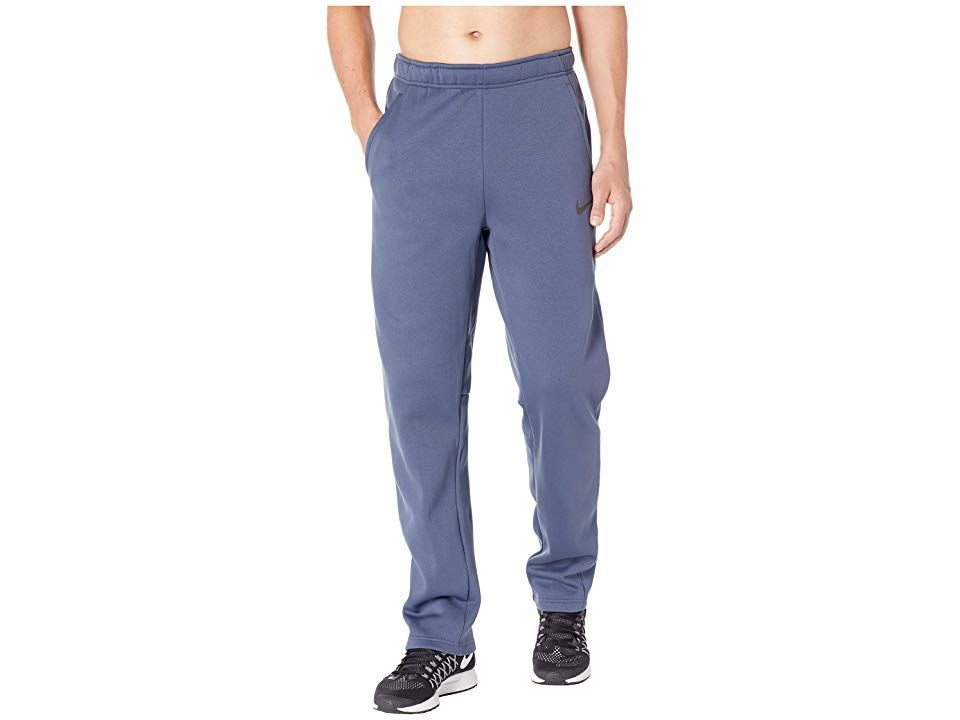 Nike DriFIT Therma Thunder BlueBlack Mens Casual Pants For those that get after it in any weather we present the Nike DriFIT Therma pants Training pants in a heatmanaging...
