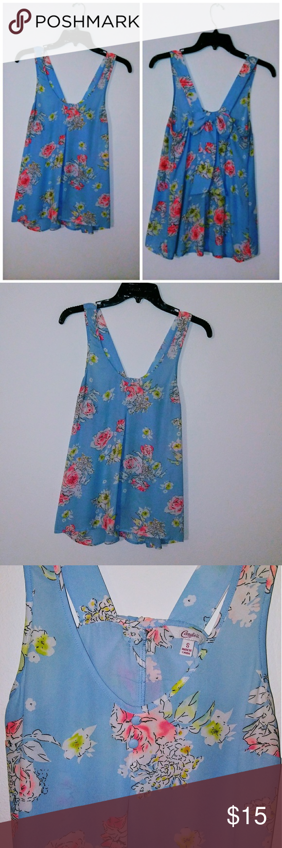 Candie's Floral Blue Shirt Floral shirt is gently used and like new. Worn a few times. Has button detail on the front and a cute bow on the back of the shirt. Great styled with jeans and a jacket if desired! Candie's Tops