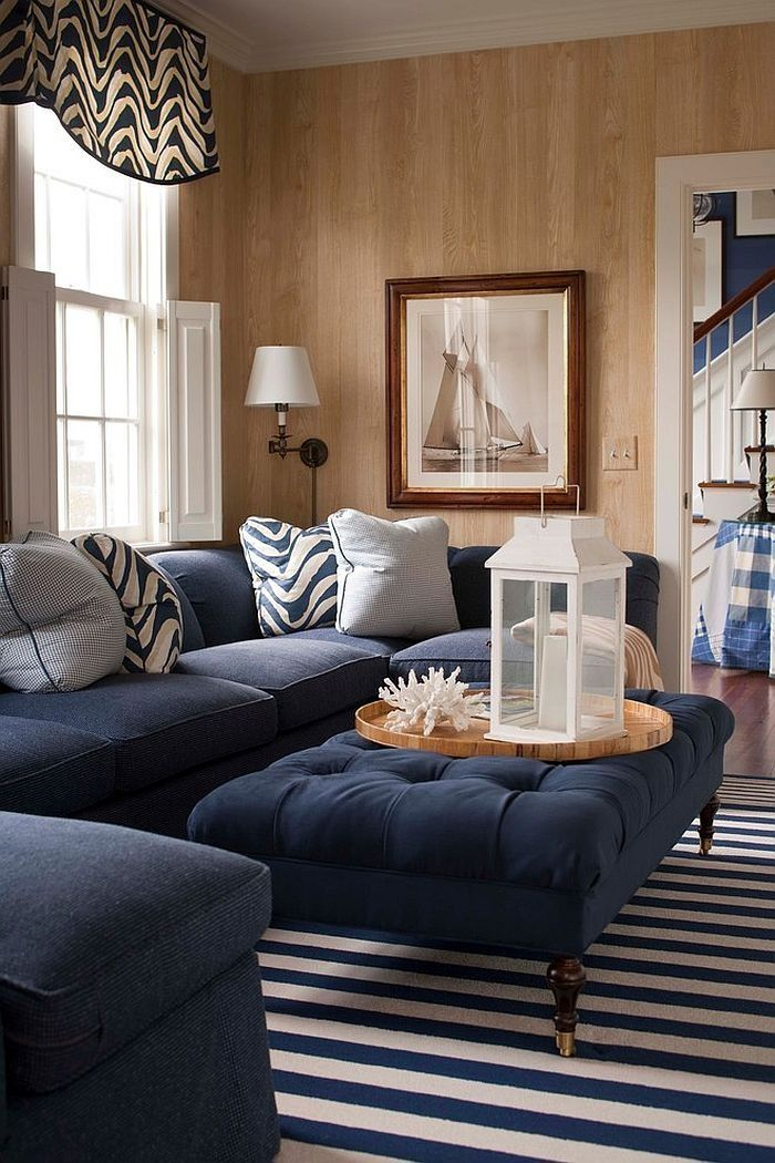Small Living Room With Unfinished Wooden Wall Containing Blue Tufted Coffee Table With Stripe Area Rug Also Blue Marine Sofa Plus Zebr Rumah Ruangan Inspirasi #royal #blue #sectional #living #room