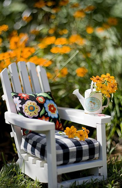 Garden Chair - LOVE the black & white checks with the flowered pillow maybe recreate for the party so V can put it on her porch