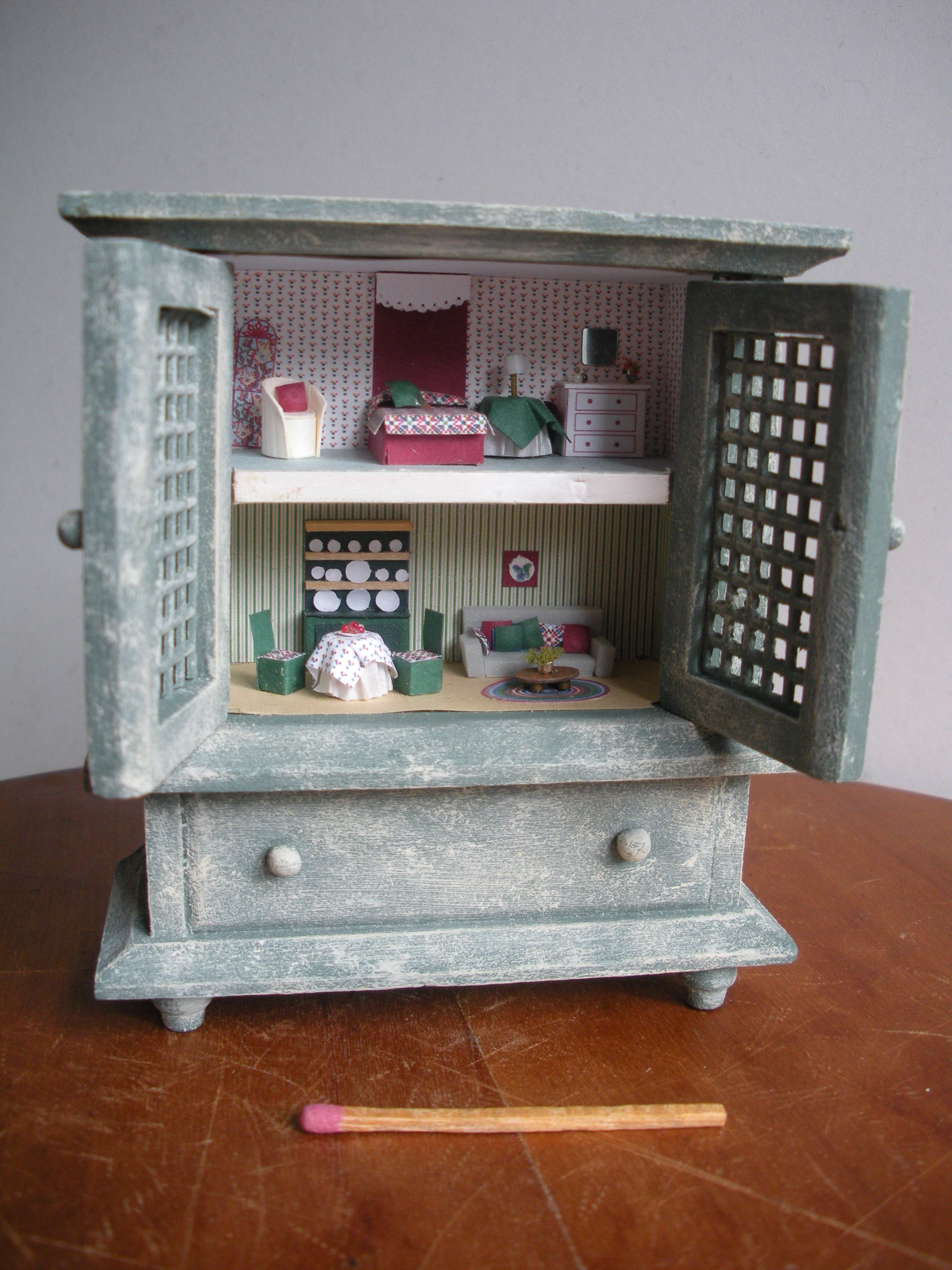 Tiny house in a cupboard 1:144 scale. Furniture made of paper and card.