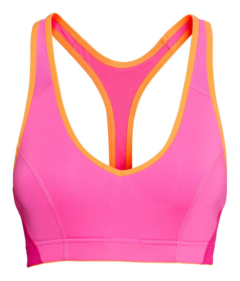 Neon pink racerback sports bra with functional fabric