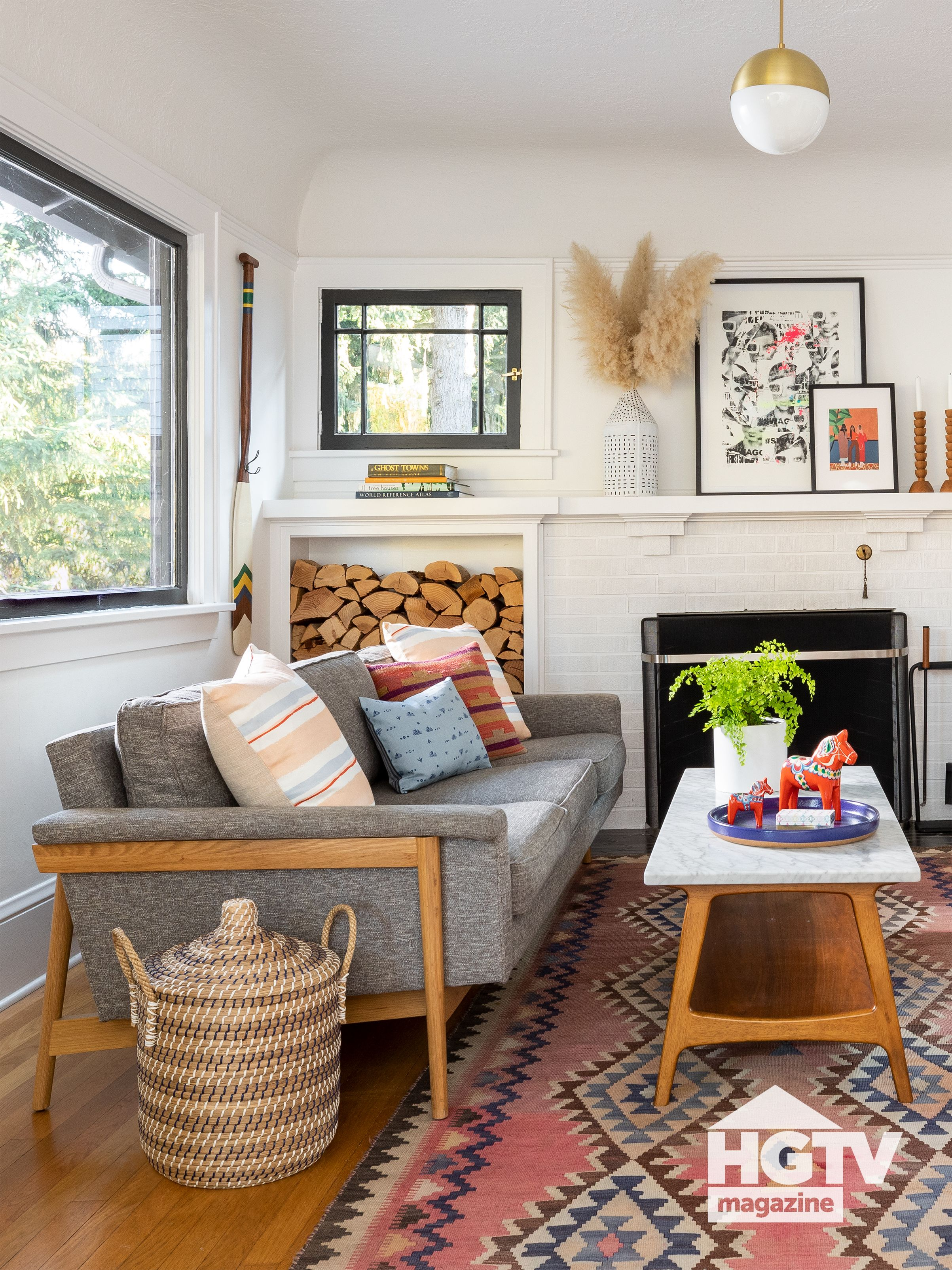 Furniture With Funky Wood Bases A Patterned Rug And Neutral