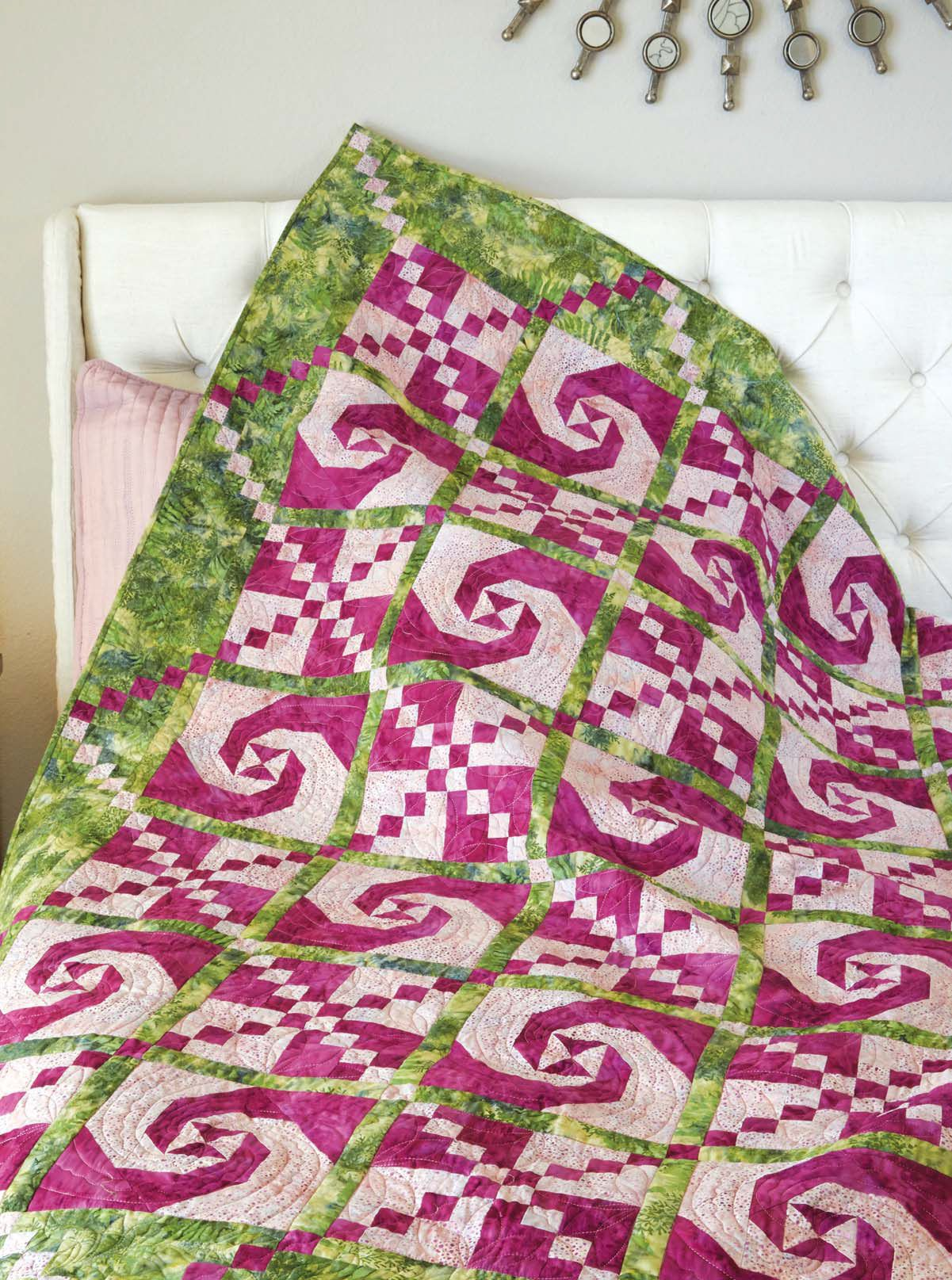 Twist and Turn quilt pattern: Shades of pink and green create this ...