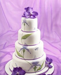 Hand painted orchid wedding cake. I don't like the painted flowers but I do like the real ones