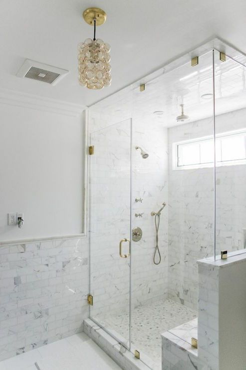 Glam White And Gray Bathroom Features White Paint On Top Half Of Walls And  Marble Tiles On Bottom Half Of Walls Finished With A Chair Rail Illuminated  By A ...
