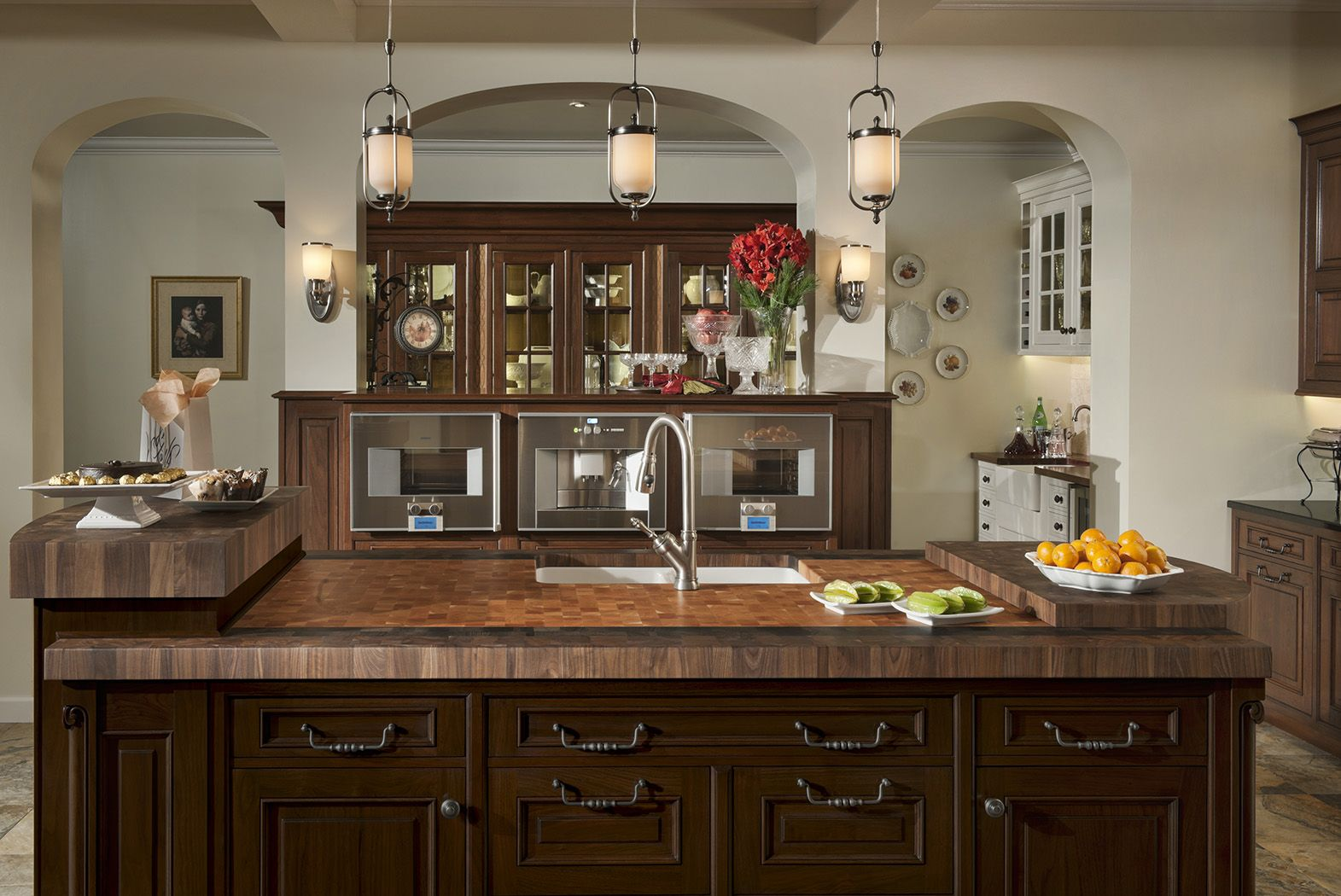 elegant traditions kitchen by woodmode shown in sable and wall street finishes on walnut on kitchen organization elegant id=32663