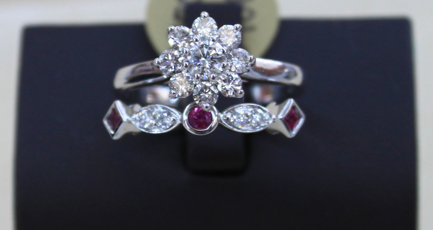 Beautiful new diamond cluster engagement ring in 14k white gold with diamond and ruby band in 14k white gold!