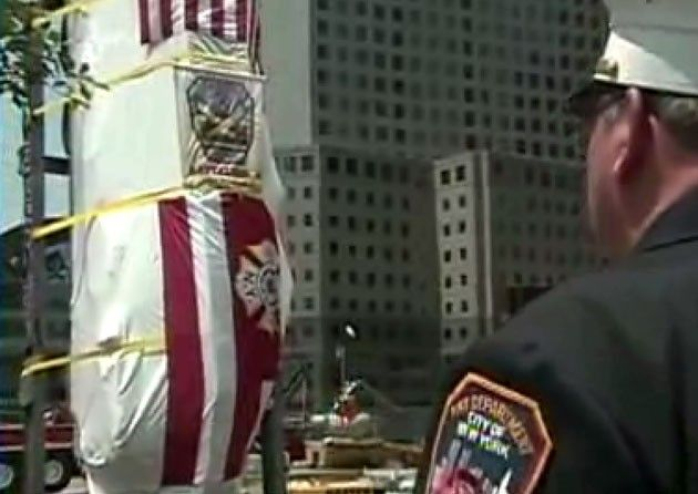 Crushed NYC fire truck lowered into Ground Zero memorial