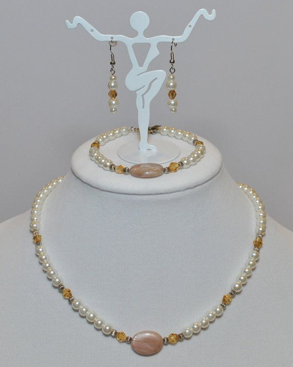Sleek sophisticated stunning.  Sunstone and pearl by BaublesDesigns4U, $49.99