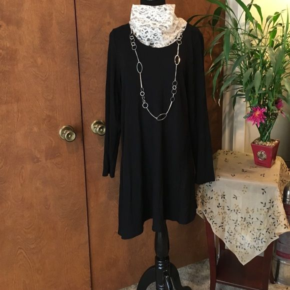 Basic lil black dress Black, long sleeved asymmetrical hem line dress. Could be worn casually or dresses up for a night on the town. Joan Vass Dresses Asymmetrical