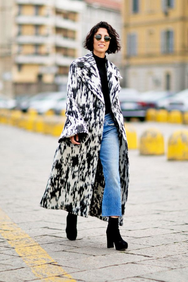 A statement coat is worn with cropped flares + platform booties