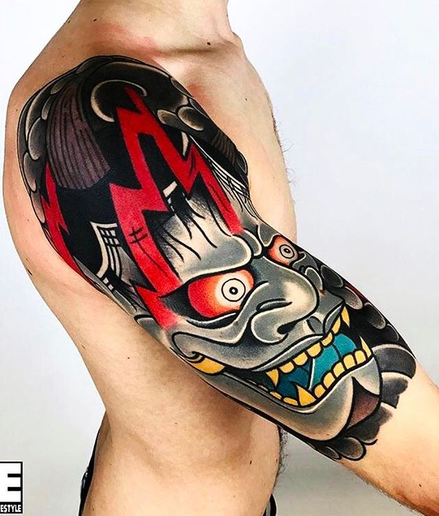 451b346b9 Love this bold Japanese mask tattoo. The design is super edgy and clear the  at the center of this tattoo. #CuratedTattoos