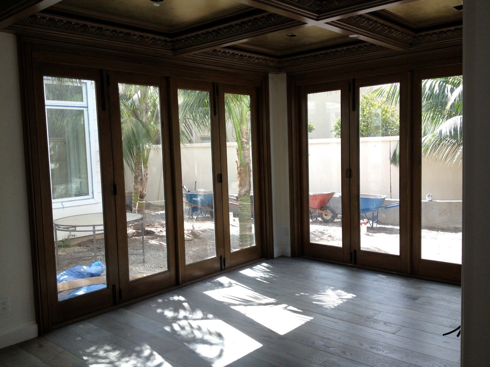accordion glass doors to block out wind and rain