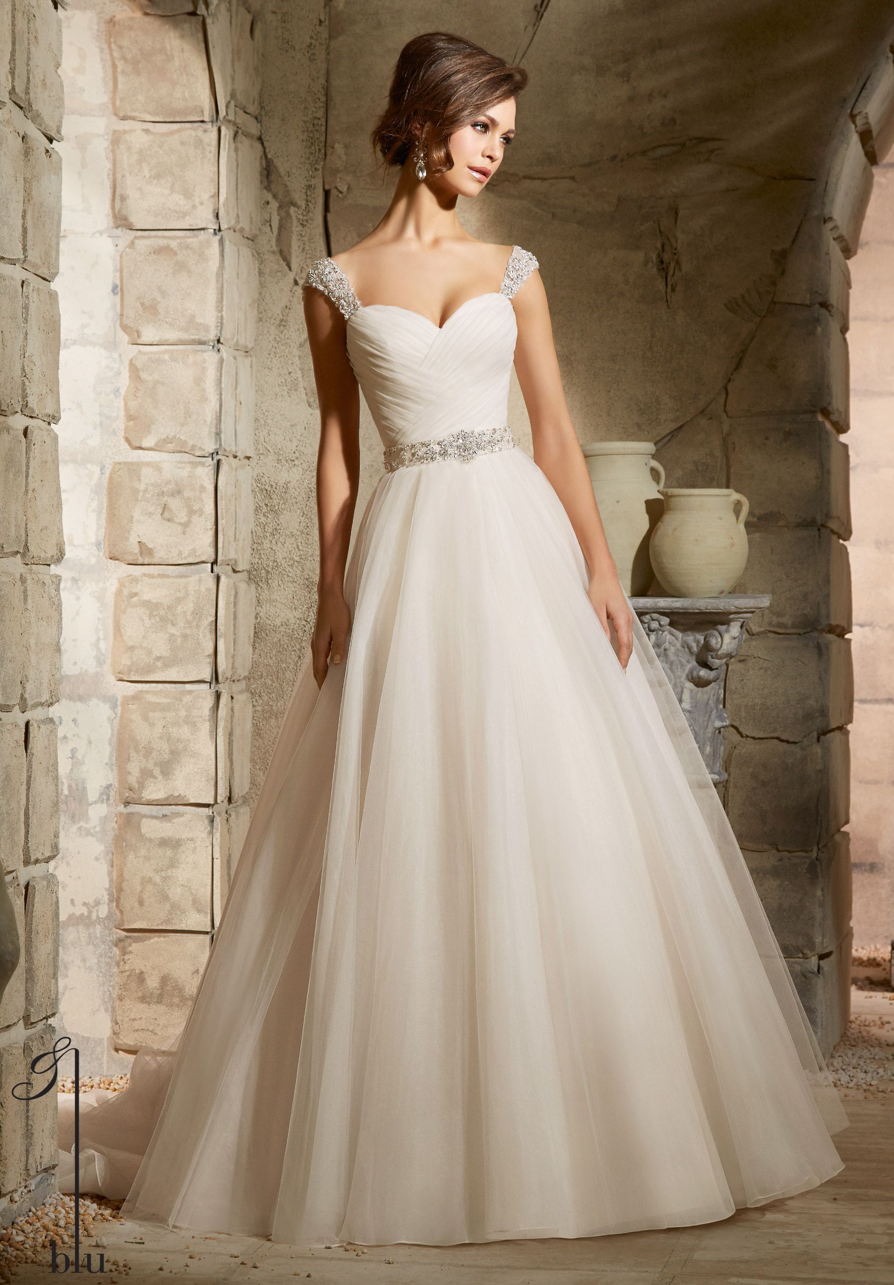 Wedding dresses for large busts  Wedding Gowns By Blu featuring Asymmetrically Draped Bodice on a