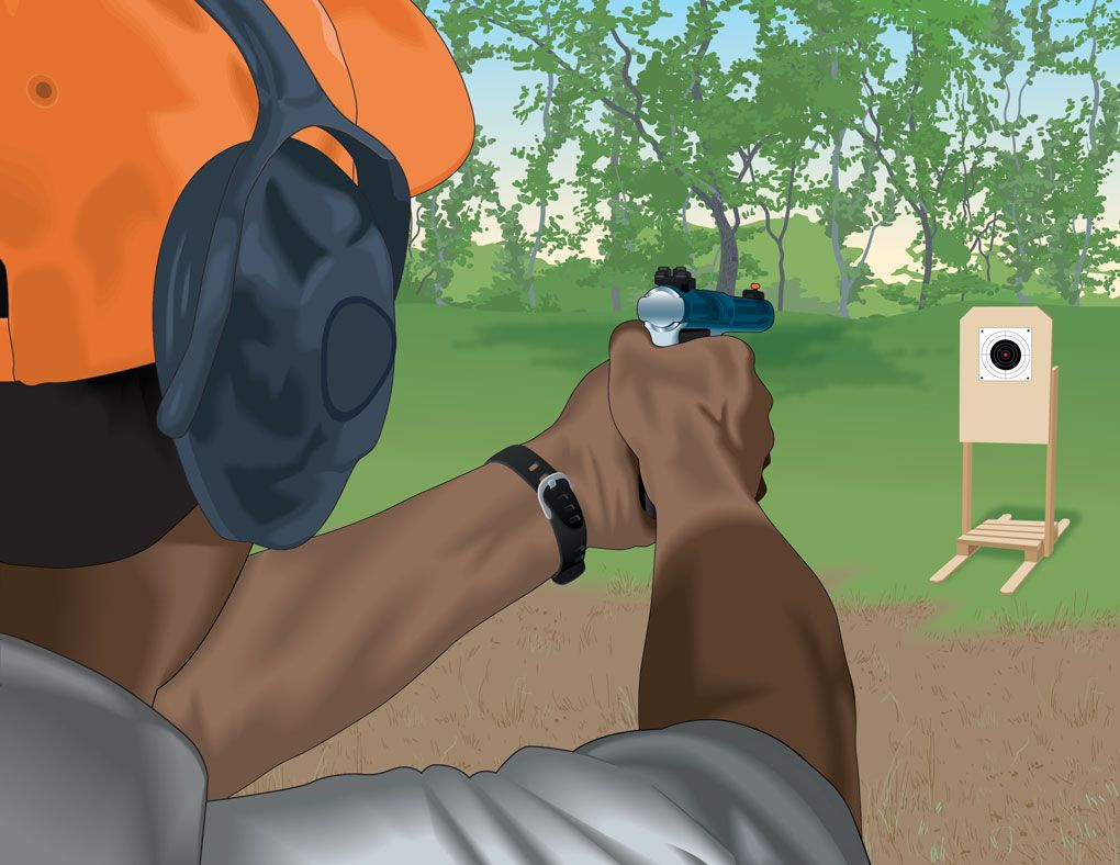 Aiming at a target with a handgun safety courses