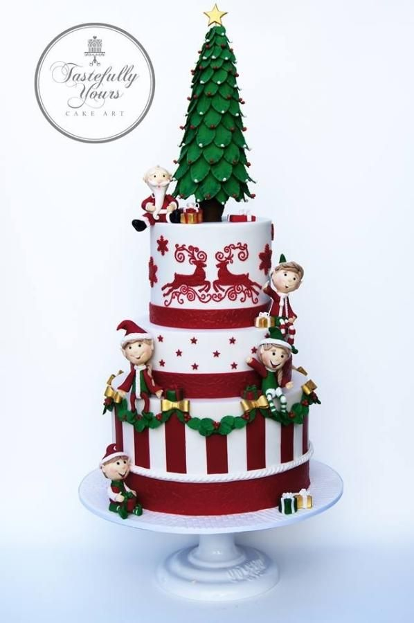 """Elegant and fun Christmas cake by Marianne Bartuccelli of CakesDecor. She says """"I chose tradition and fun as the elements. Tradition is the wreath, stripes, Christmas tree and reindeer that was piped to look like tapestry. And the fun came with..."""""""