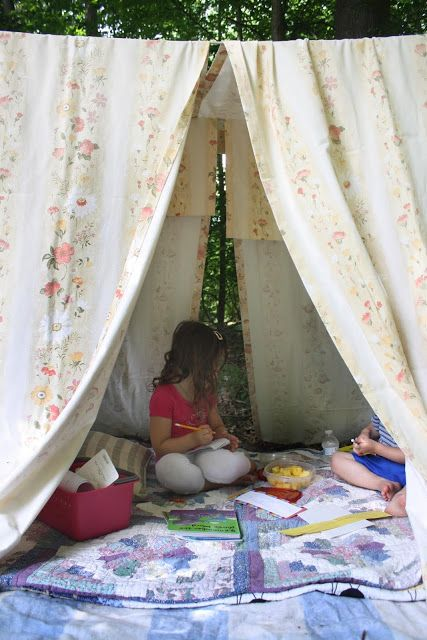Some old blankets, sheets, and old curtain panels and... the perfect spot in your yard to set up your homemade tent.