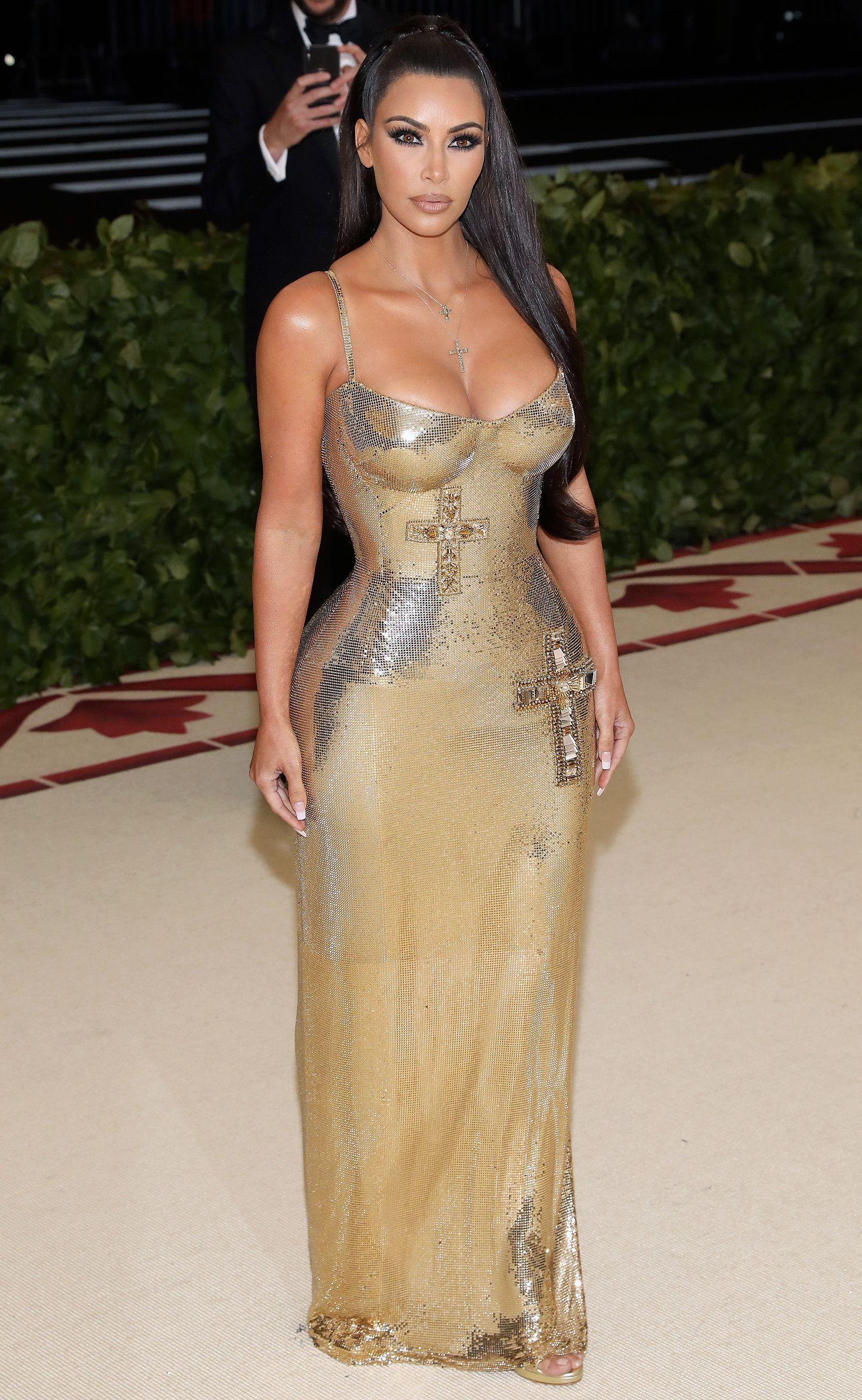 ec5996cf638 Kim Kardashian Attends the 2018 Met Gala without Kanye West Wearing Sexy  Gold Versace Dress