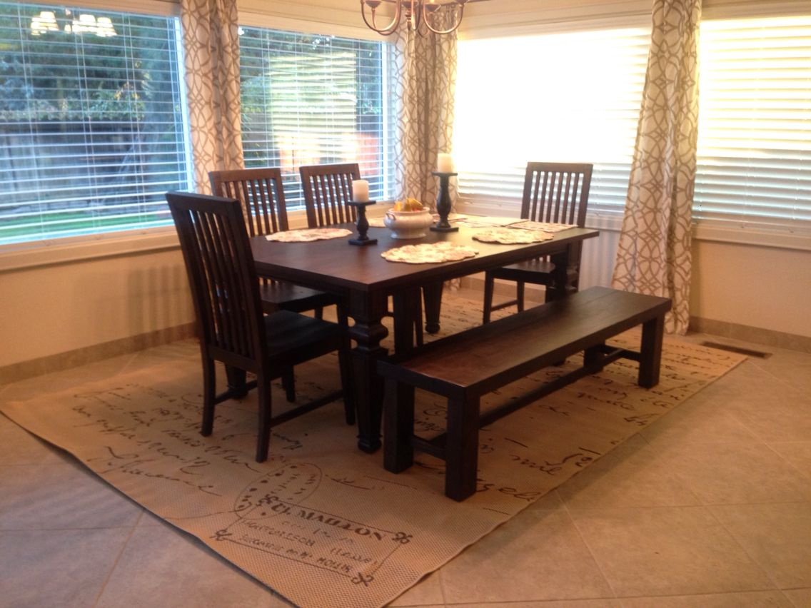 The dining area in the kitchen. Indoor/outdoor rug from ...