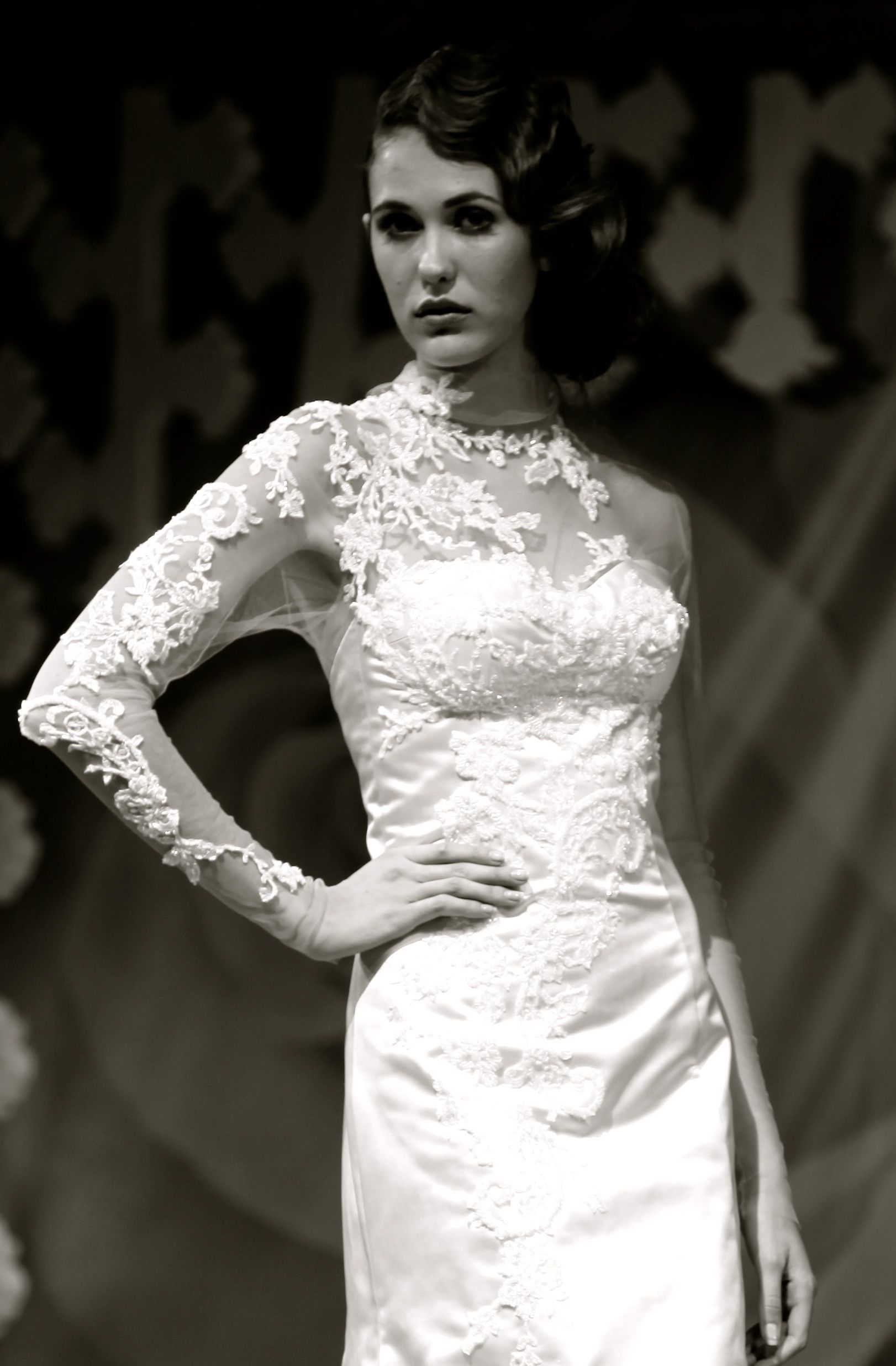 Hand-stitched lace and bead applique.  Dress by The Couture Gallery designer Britta Kjerkegaard