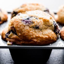 Make these big bakery style blueberry muffins in a jumbo muffin pan! Super moist with tall muffin tops, these muffins are made with sour cream, melted butter, oil, and loads of juicy blueberries. A favorite recipe on sallysbakingaddiction.com