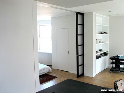 Use bookcase wall to support accentuate pocket door for Sliding walls residential