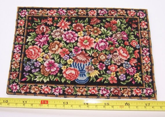 A beautiful hand stitched petitpoint, miniature carpet that will be a lovely addition to your 1:12 scale dolls house.  Wonderful for the bedroom or living room. Features an extravagant display of roses, peonies, foliage and other blooms on a black background.  I have rescued and refurbished this vintage petit point panel and given it a new purpose as a miniature carpet. It is light and flexible and will lie perfectly flat in your dollhouse. Just the right thickness for a realistic 1:12 scale…