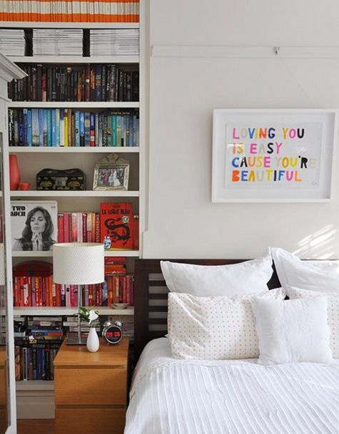 I love the picture hanging above the bed...and I had never thought of color coding the books it really looks neat! & sneak peek: best of book storage | Bedrooms Book storage and Shelves