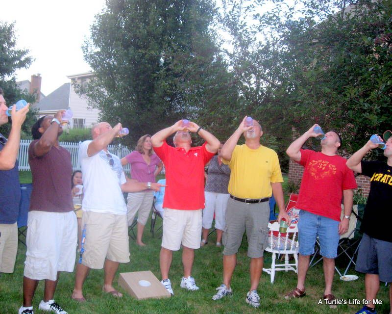 Fun Baby Shower Game, Everyone Drinking Beer Out Of A Bottle! Lol.