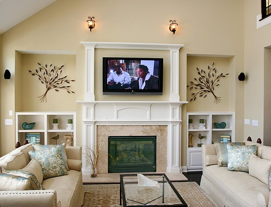Shelving around Fireplace : Best Modern Fireplace Design Ideas : Luxury Living Room Design With Cream Sectional Sofa And Glass Coffee Table And Granite Fireplace Surround And Wall Mounted Tv Stand Beside Classic Wall Sconce