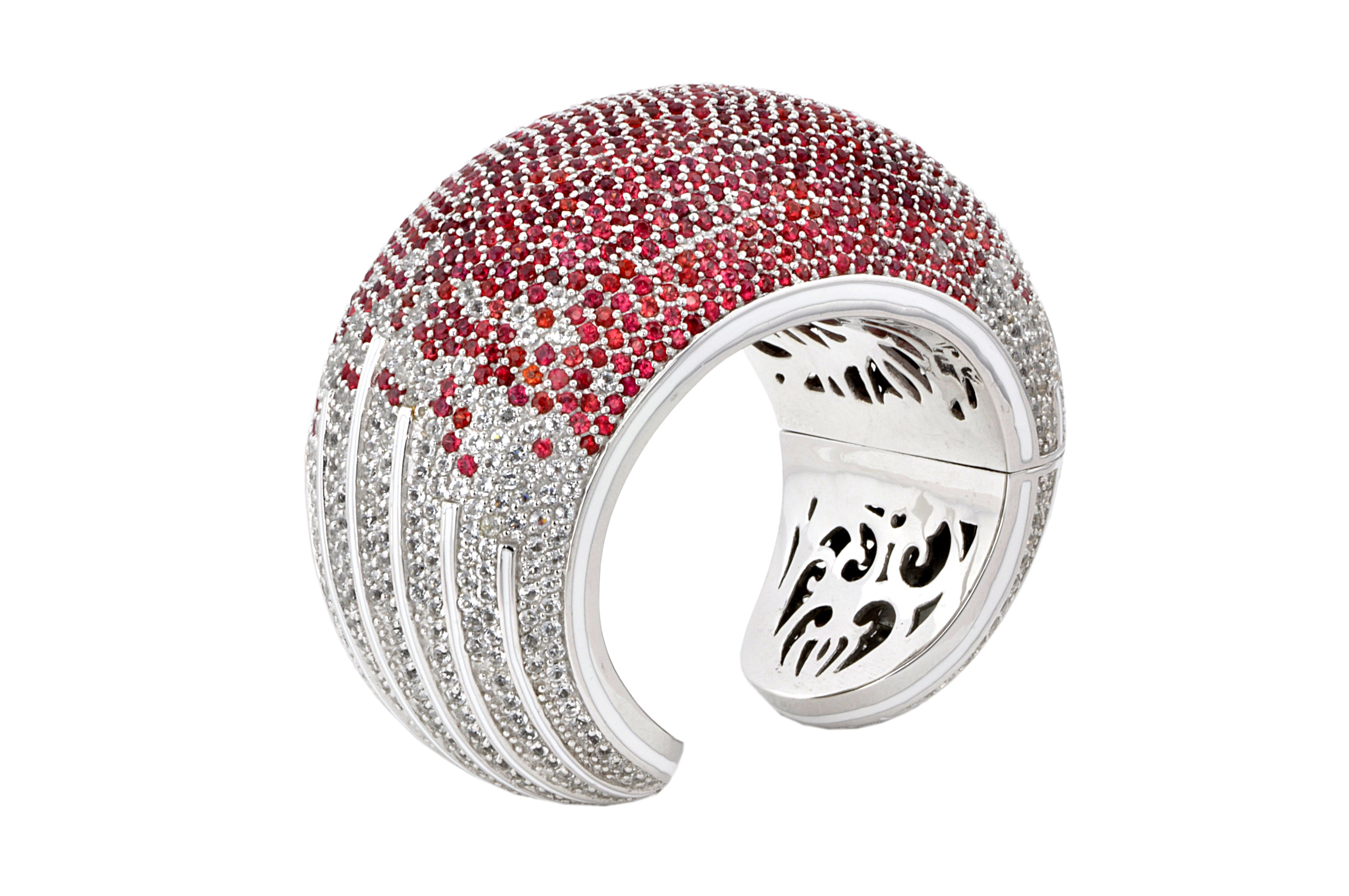 Manhattan Cuff from The Manhattan Collection: hand made 925 sterling silver plated with silver rhodium, hand-set with red sapphires and white topaz accented by white enamel.