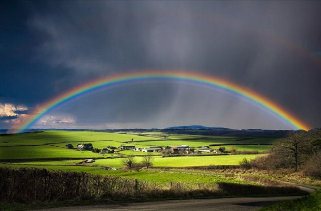A stunning shot taken by photographer Kris Dutson in Dorset, England. The colours are breathtaking and the full rainbow a treat! We love it!