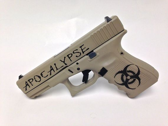 A Glock 23 Gen4 40 caliber pistol with some custom zombie