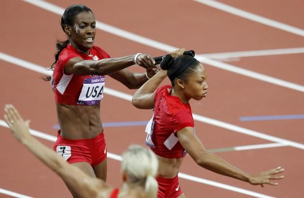Allyson Felix of the U.S. takes the baton from compatriot DeeDee Trotter in the women's 4x400m