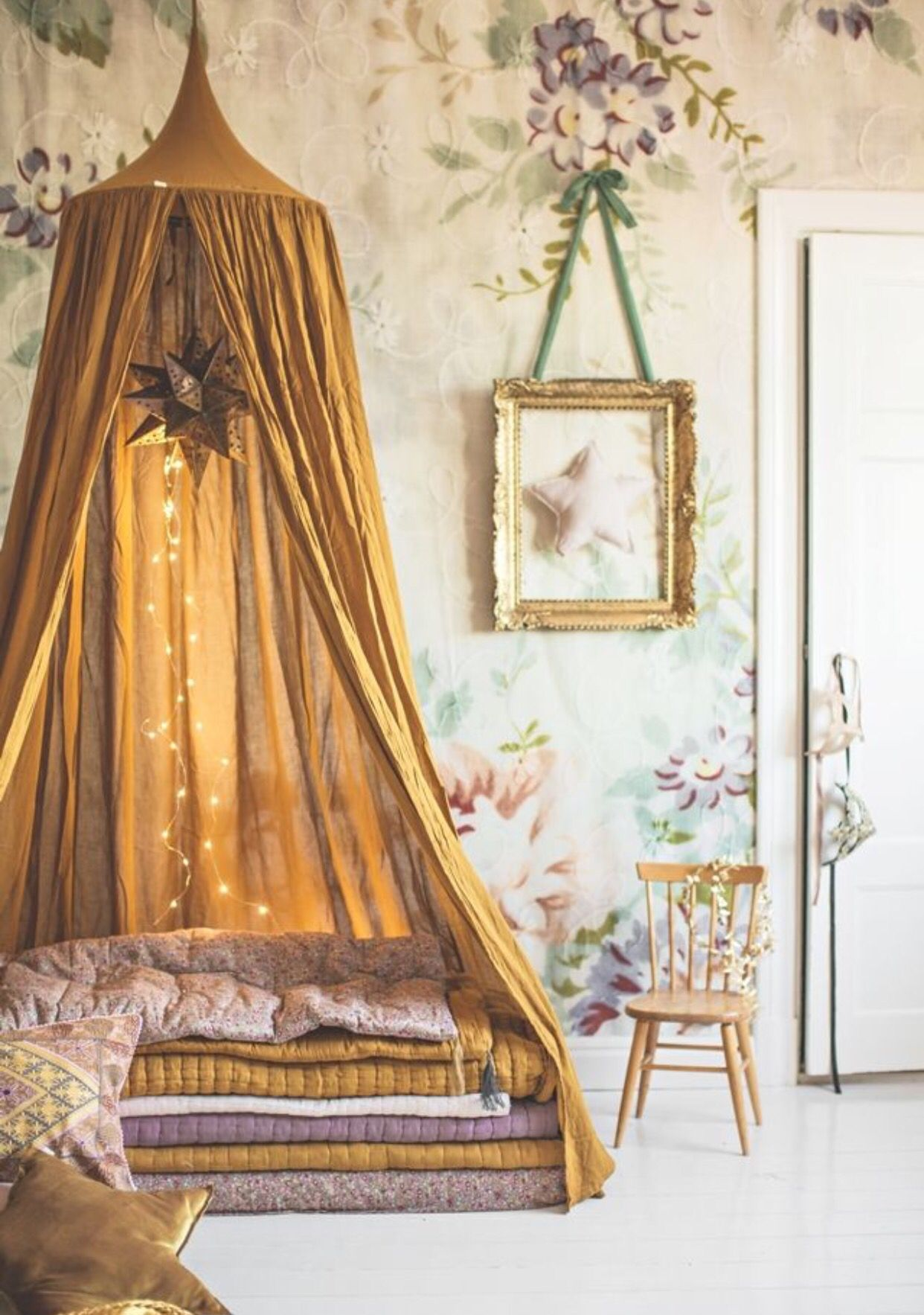 This honey yellow creates the perfect focus on the lovely teepee bed
