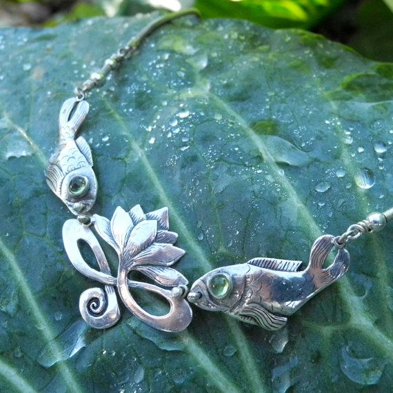 This magical lotus and fish silver necklace...