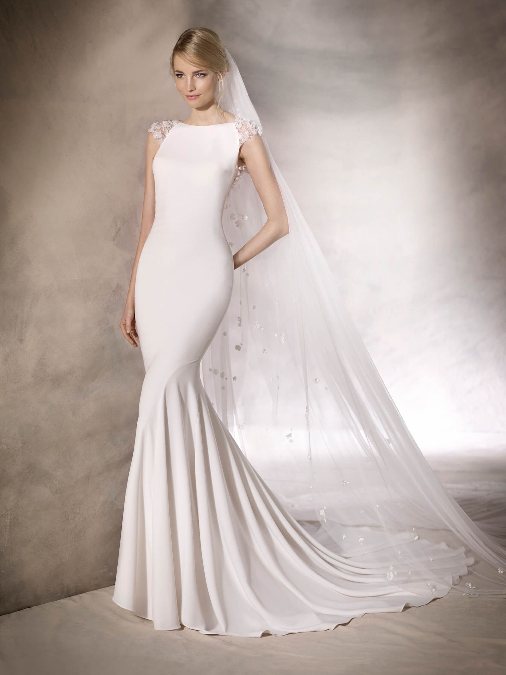 Halory is an extremely elegant wedding dress with a bateau halory is an extremely elegant wedding dress with a bateau neckline in crepe and tulle ombrellifo Image collections