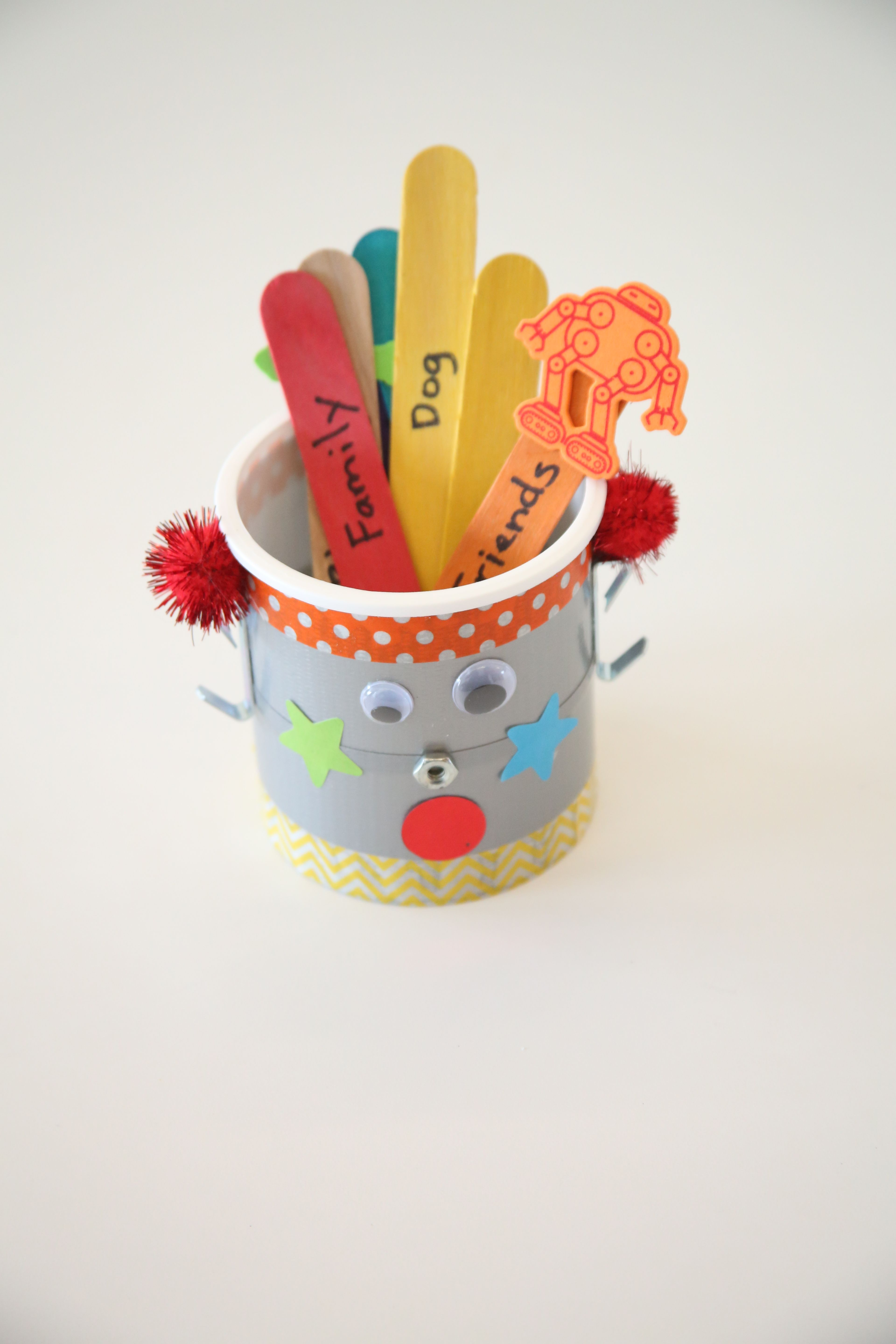 Blessings Bot Kids Will Love Decorating This Craft A Clean Recycled Frosting Container Was Used As The Base Of The Vbs Crafts Craft Stick Crafts Kids Writing