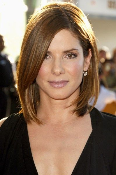 This straight long bob with long side swept bangs is a chic yet easy hairstyle for women over 40