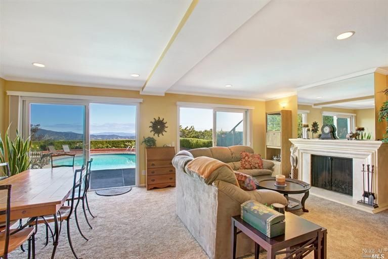 Large family room with views of the serene hillsides and surrounding area. See more homes like on www.fhallen.com.